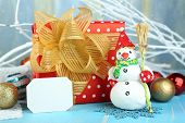 Beautiful Christmas composition with gift and Christmas toys close-up