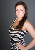 Shot Of A Stunning Brunette Teenager In Zebra Print Dress