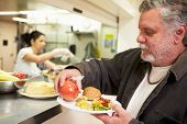 pic of charity relief work  - Kitchen Serving Food In Homeless Shelter - JPG