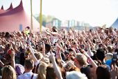 stock photo of audience  - Crowds Enjoying Themselves At Outdoor Music Festival - JPG