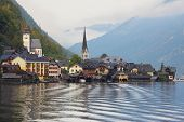 The most picturesque small town in Austria - Hallstatt. Slender belfry and Lutheran church on the sh
