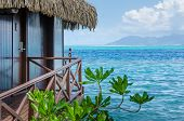 Overwater bungalow with view of amazing blue lagoon