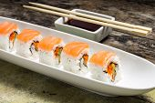 Seafood Sushi Rolls In White Long Dish With Soy Sause
