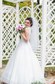 Young beautiful bride with bouquet