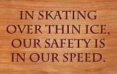 In skating over thin ice, our safety is in our speed - quote by Ralph Waldo Emerson on wooden red oak background