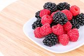 Blackberry And Raspberries On White Plate
