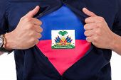 Young Sport Fan Opening His Shirt And Showing The Flag His Country Haiti, Haitian Flag