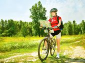 Happy young woman riding bicycle outside. Healthy lifestyle. Outside