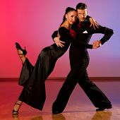 pic of waltzing  - Professional ballroom dance couple preform an romantic exhibition dance - JPG