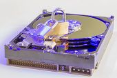 Data Security: Lock Sitting On A Hard Disk Drive