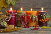 Autumn candles with leaves vintage abstract still life