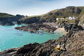 Tourists and holidaymakers enjoying late summer sunshine at Kynance Cove beach Lizard Heritage coast