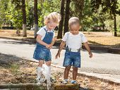 Baby Boy And Adorable Child Girl In Park. Summer Green Nature . The Concept Of Childhood And Love