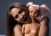 Photo of crying girl with the doll