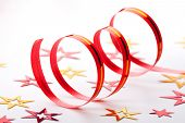 Ribbon And Confetti On White Background
