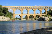 stock photo of aqueduct  - Roman aqueduct at Pont du Gard France UNESCO World Heritage Site - JPG