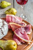 Slices Of Italian Ham On The Wooden Board