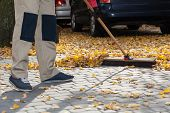 Brooming Driveway From Leaves