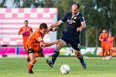 Sisaket Thailand-september 21: Vadin Lyubinskiy Of Roi Et Utd. In Action During Friendly Match Betwe