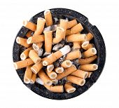 foto of butts  - Ashtray full of cigarette butts isolated on white background - JPG