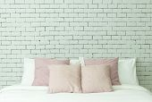The Bed On White Bricks Wall Background