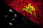 stock photo of papua new guinea  - grunge flag of Papua New Guinea with capital in Port Moresby - JPG