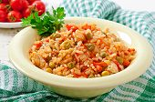 Pilaf with chicken, carrot and green peas