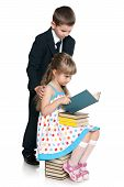 Little Boy And Girl Are Reading