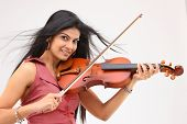 smiling teenage girl playing violin