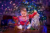 Baby Under Christmas Tree