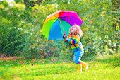 Funny Little Girl With Umbrella