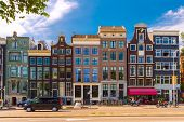 City View Of Typical Amsterdam Street With Dutch Houses, Holland, Netherlands.