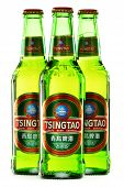 Bottles Of Tsingtao Beer Isolated On White