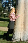 Girl Leaning On A Tree - Looking Away From Camera