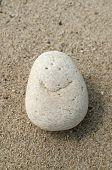 Smile on pebble stone