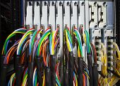 foto of electric socket  - arrangement stack of colorful electronic cable wire socket hub in telecommunication control room - JPG