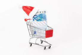 pic of caddy  - Caddy for shopping with money stack on white background - JPG