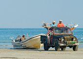 Fishermen after fishing in Al Khaluf, Oman