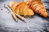 picture of croissant  - Breakfast setting with fresh croissants and copyspace - JPG