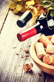 Bottles Of Red And White Wine With Bunch Of Corks