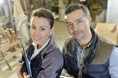Woman with trainer in carpentry workshop