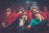 stock photo of watching movie  - Group of people in 3D glasses watching movie in cinema - JPG