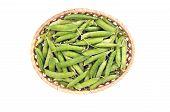 Fresh Sweet Pea Pods In Wicker Basket