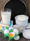 ingredients for making pancakes - flour, eggs, yeast and sugar