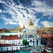Beautiful view on Grand canal and Basilica Santa Maria della Salute in sunset
