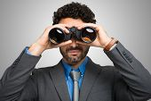 picture of binoculars  - Businessman watching through binoculars - JPG