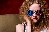 Young Girl With Curly Hair Wearing Sunglasses