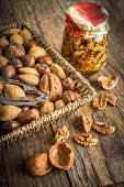 foto of nutcracker  - steel nutcracker and nuts of various kinds nuts in honey - JPG