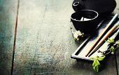 Chinese Tea Set,chopsticks and sakura branch on rustic wooden table