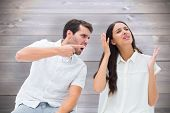 Couple sitting on chairs arguing against wooden planks background